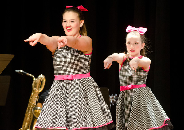 "Sydney Crotteau (left) and Fiona Dooley perform ""Welcome to the 60's"" from the musical, ""Hairspray."""
