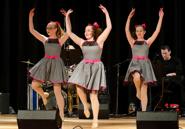 "Annika Roos, Hope Nichols and Kacey Regan (from left) perform to ""Welcome to the 60's"" from the musical, ""Hairspray."""