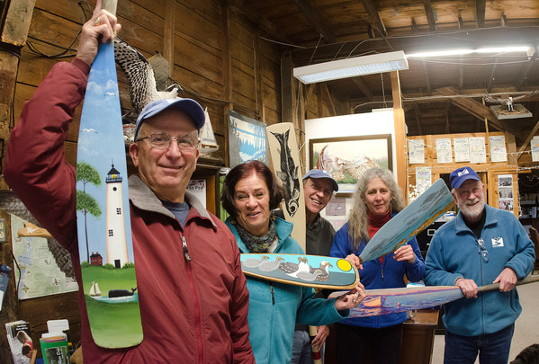 Artist Ray Audet holds the oar that he painted. With him, from left, are his wife Lorraine, and Steve Connors, Deborah Weaver and Tom Schmidt.