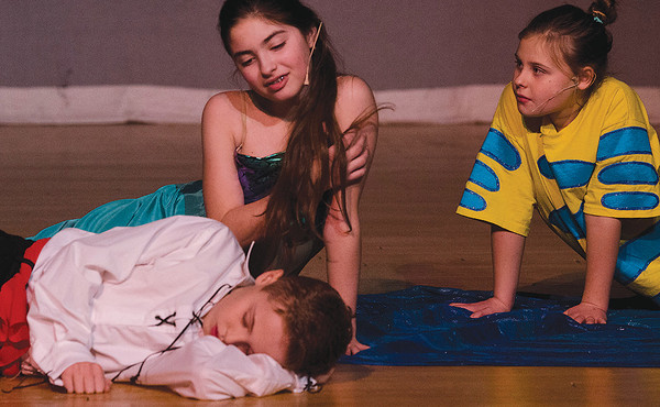 Hadley Fitton as Ariel, Ella Turenne as Flounder and Gavin DeMoura as Prince Eric rehearse a scene in which Ariel saves Eric from a shipwreck.