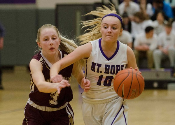 Jenna Cimbron dribbles up court with Tiverton's Ireland McGreavy in tow. Cimbron scored a game high 22 points for the Huskies.