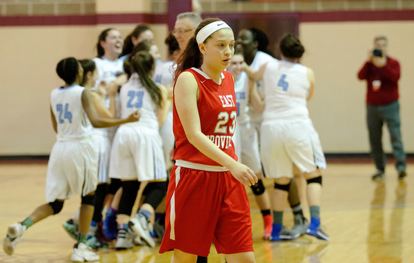 Townies forward Hailey Hannon walks off the court as Johnston celebrates after winning the D-II championship.