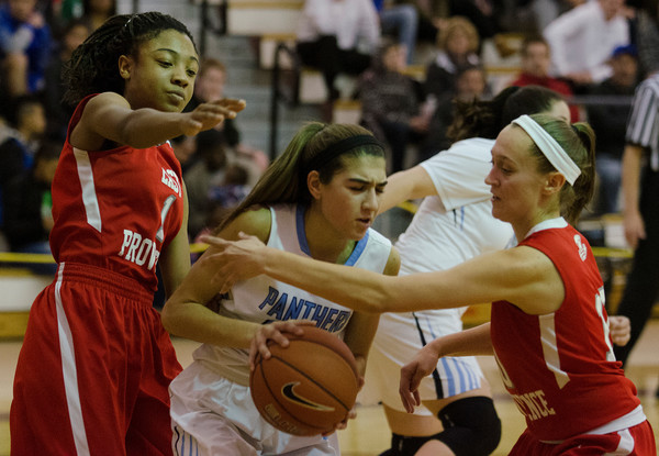 Shaniah Hazard (left) and Emma DaSilva double team a Johnston forward during the game.