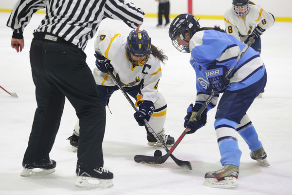 Grace Flaherty waits for the puck to drop during a face-off.