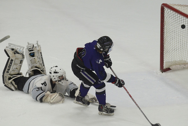 Dylan Andrade beats Pilgrim goaltender Kyle Demascio in the second period.