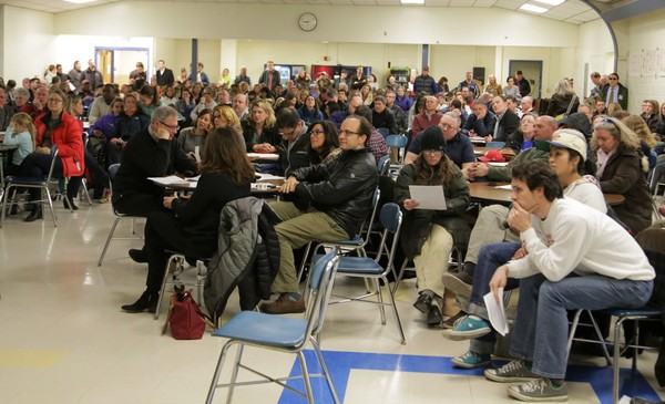 Hundreds of people watched the Barrington special financial town meeting from closed circuit televisions inside the cafeteria.