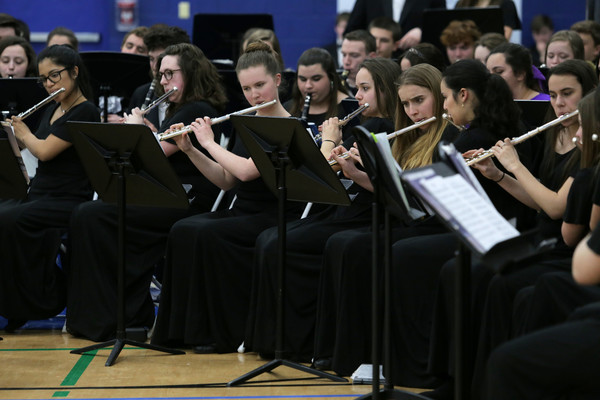 Flute playing members of the Mt Hope Concert Band perform during the All Band Concert held at Roger Williams University.