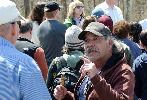 Pocasset Wampanoag Tribe medicine man Andrew Noronha talks with a Tiverton official during the tour.