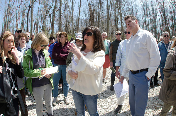 Twin River employees Chris Shea (mid-left) and Mark Russo (right) give a guided tour of the casino site on Saturday.
