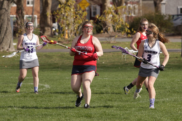 Grace Blythe, senior co-captain, defends the Portsmouth goal in the final seconds of the first half.