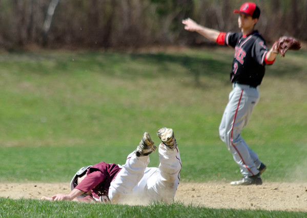 Chris Medeiros dusts himself off after sliding during a steal and coming up short of second base for an easy Durfee tag out during their game on Friday.