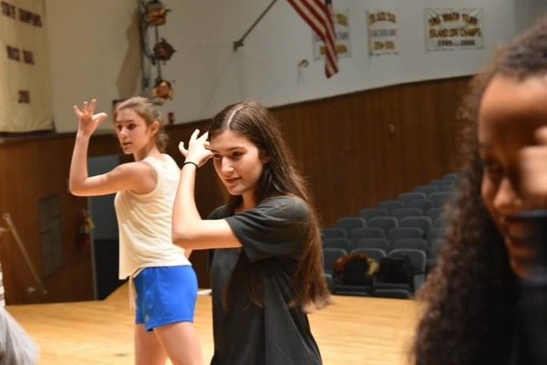 From left, Emily Caraveo and Ashley Duluc rehearse a scene from 'A Chorus Line.'