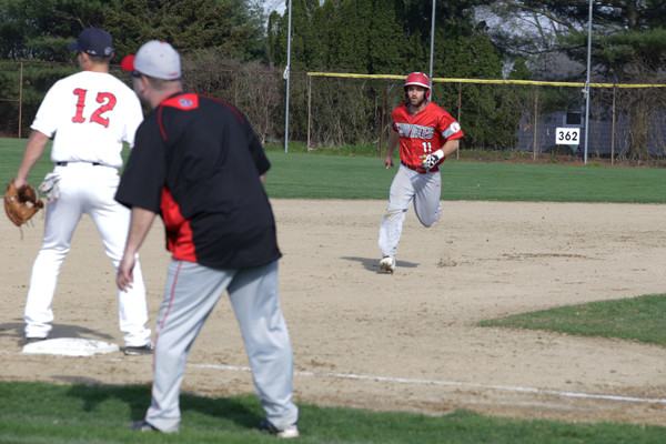 EPHS senior Andrew Rodrigues heads toward third base after an East Providence teammate sent a ball to the outfield.