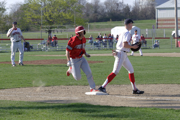 EPHS sophomore Zach Fanara runs through first base after a close play at the bag.