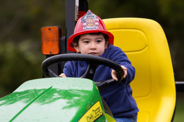 Matthew Senra gets behind the wheel of a John Deere tractor at last year's Touch-a-Truck event.