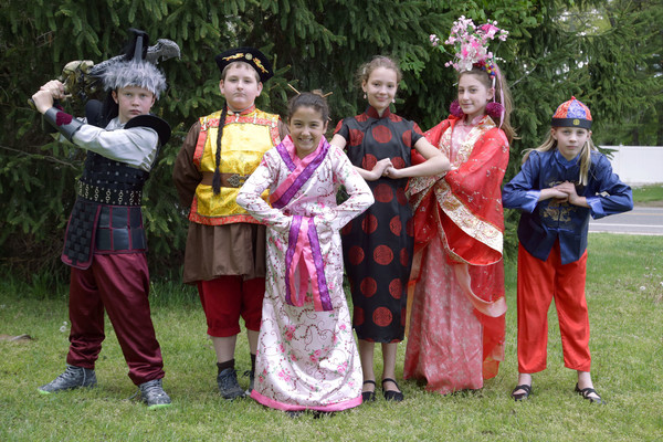 The cast of the Hampden Meadows School production of Mulan, Jr. (from left to right) Andrew Helm, Adam Godfrey, Ashley Pippitt, Lilly Robinson, Talya Davis and Kendall Fisher pose for a photograph outside the school.