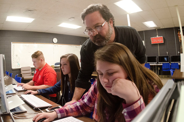 Media instructor Gary Vaspol helps Leah Paulon edit a video piece.