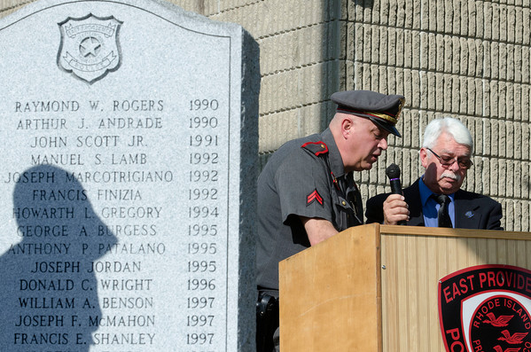 Retired Detective Corporal John Rossi (left) and Pat Brooks read off the Roll Call of Heroes during the Eat Providence Police Officers' Memorial Service  in front of the police station on Thursday.