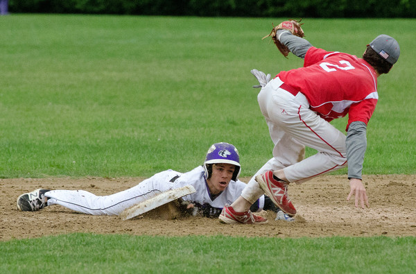 Mounties Jacob God tags out Huskies Cam Santerre on a steal attempt with two outs in the seventh inning and the Huskies trying to comeback from a 4-1 deficit.