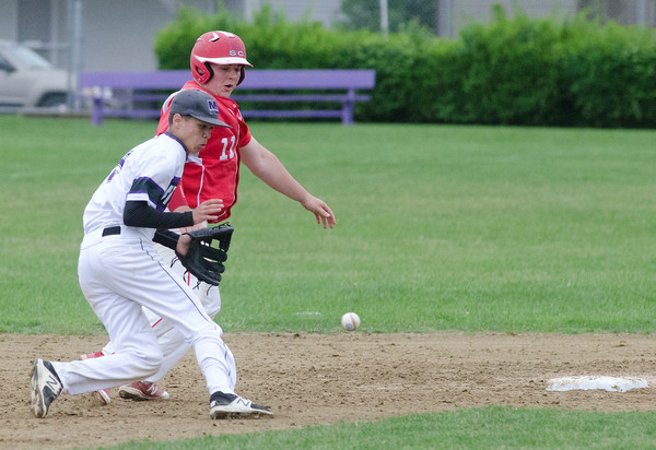 Shortstop Cam Santerre fields a ball by second base.