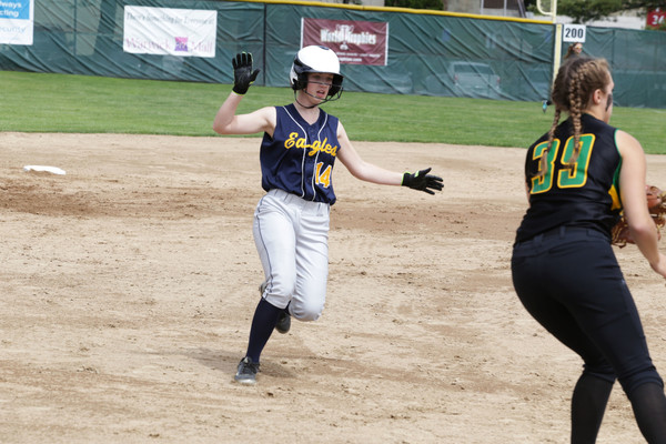 Sophomore Heidi Grove runs hard to third base during the Eagles' game against North Smithfield.