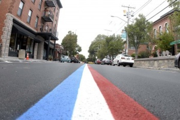 Hope Street's red, white and blue center line marks the final phase of construction.