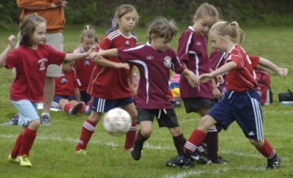 Girls in the eight and under age group take part in some scrimmage action Saturday.