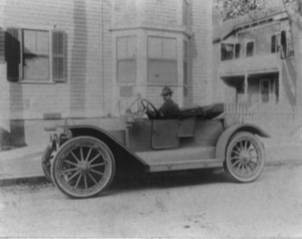 In this photo, from the collection of the Warren Preservation Society, Dr. Frederic P. Drowne sits in his new car on 8 Child St. in 1914. Society members have been trying to research the car but haven't yet been able to identify it, due to the large number of manufacturers during the time period. Two possibilities are a 1914 Monroe Model 165 Roadster (a fairly cheap car), and the Chevrolet Royal Mail H-2 which was popular in New England during this time period. Courtesy Warren Preservation Society.