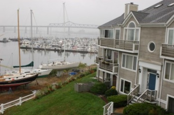 This two-level condo features two private balconies with views of Mt. Hope Bay.