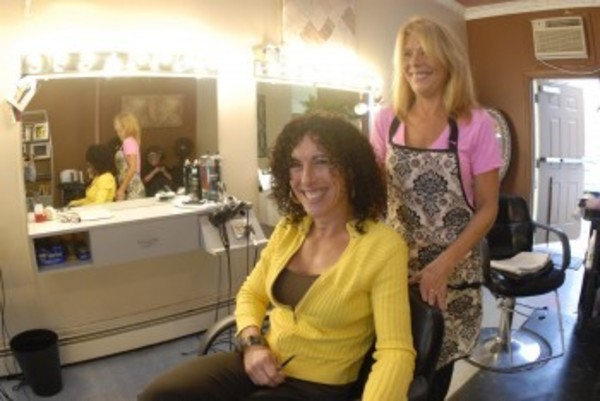 Peggy Murgo (seated) and Ann Mello, began A New Look Salon on Hope Street on Oct. 17, 1987. After 25 years, the two decided to move on.