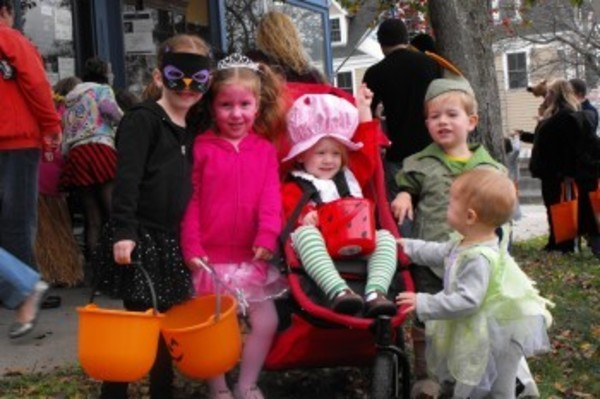 (left to right) Sienna, 6, Alexa, 4, and Kayla Sousa, 2, came dressed for the occasion with their friends, Wyatt, 2, and Flynn Hancock, 1, where their families enjoyed the Bristol Merchants Association Halloween Walk-a-Bout on Sunday.