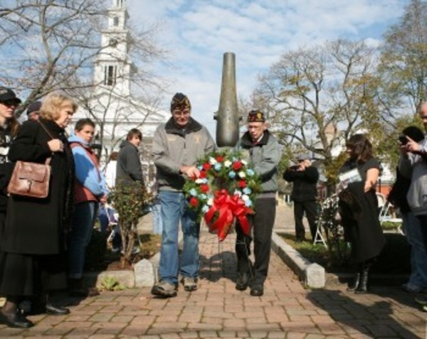 Veterans lay a wreath on the Town Common Honor Roll during Veterans Day ceremonies Sunday morning.