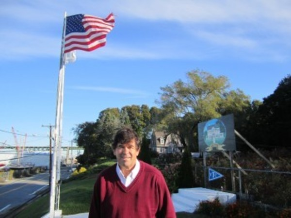 Greg Jones, Commodore of the Tiverton Yacht Club, stands on the club's grounds in 2010, uphill from the site proposed for the new septic system that is the subject of a new zoning proposal.