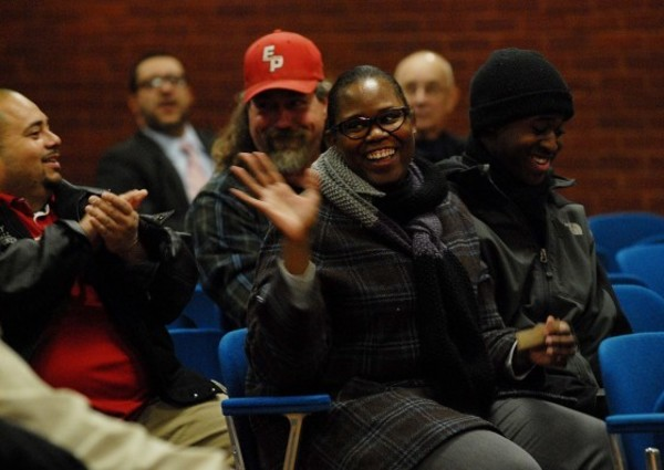 Photos by Rich DionneRenee Francis and her son Kendall, 18, react after winning the house lottery at the East Providence city meeting on Tuesday night.