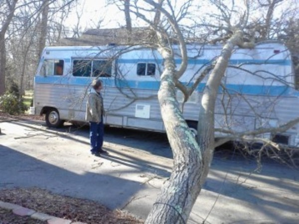 On Friday afternoon, Chris Buckley contemplates the damage done to his motor home by Thursday's wind storm. He was waiting for the electric company to show up.