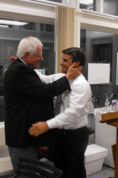 Rep. Kenneth Marshall, right, receives congratulations from Democratic town committee chairman, John Faria, after winning the 2012 primary.