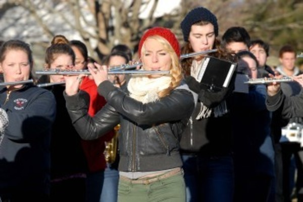 Flutist Carly Peckham marches with the Portsmouth High School band during practice last week.