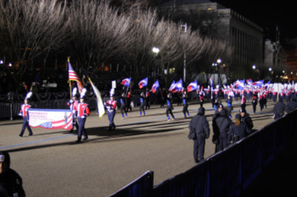 The Portsmouth High School marching band, color guard and dance team head down Pennsylvania Avenue. Photo by Matt Wilkinson.