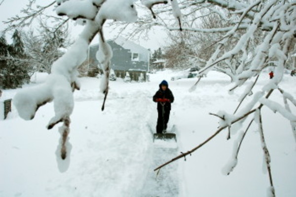 Ben Farrea was hard at work Saturday morning, shoveling in front of his family's home on Hunter Road.