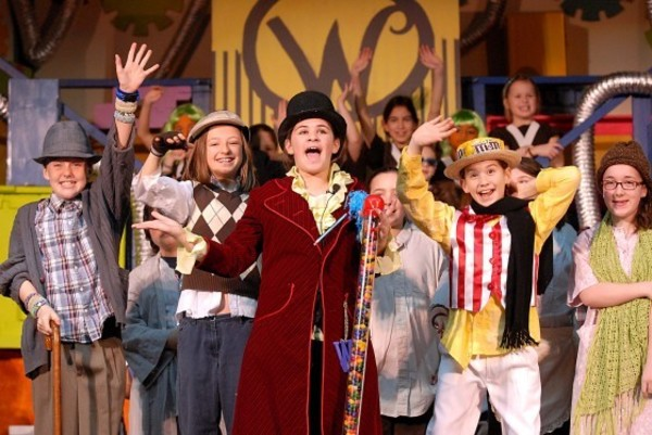 Photo by Rich DionneFrom left, Zoe Mouligne as Grampa Joe, Ellery Sparkman as Charlie, Tess Dugan as Willie Wonka, Samantha Martins as Candyman, and Brooke Hyllested as Grandma Josephine star in Guiteras Elementary School's Willie Wonka Jr.