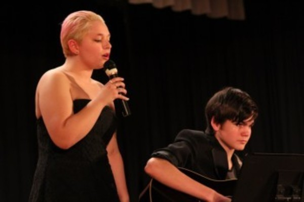 Kat Felingiere and CJ Gerhardt perform during the competition.