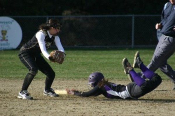 Jessica Delawder dives head first into second base, avoiding a Portsmouth tag.