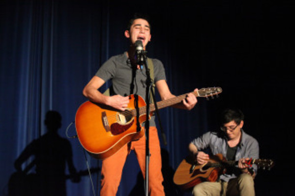 Daniel Marques entertains the crowd with voice and guitar Friday. By evening's end he would be crowned Mr. Westport, 2013.