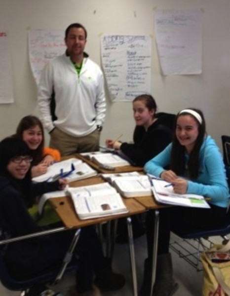 Teacher Chris Higgins works with Westport students Reilly Cusick, Kylie Cooper, Mary McGuill, and Sydney Oliveira. It is this sort of critical teaching attention that chronically truant students miss.