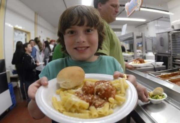 Waddington 5th grader Noah Boudreau shows off his plate of pasta.