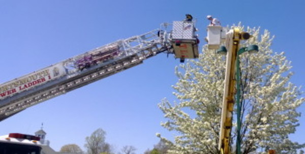 Firefighters in a ladder truck come to the aid of the Henderson Electrical worker. Portsmouth Fire Department photo.