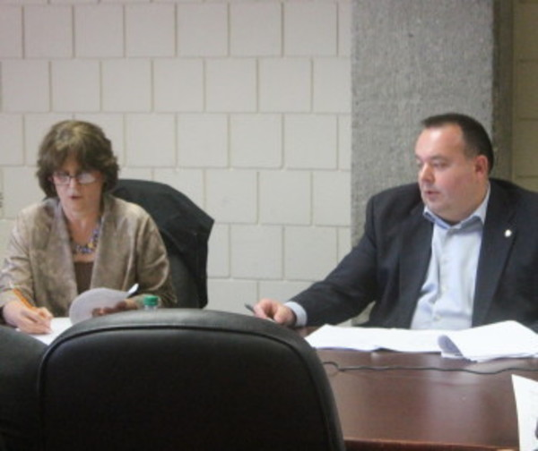 Budget Commission Chairman Diane Brennan and member Peter Graczykowski discuss a matter during the overseers' May 2 meeting.
