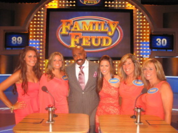 The Grant family from Barrington will compete on Family Feud. Members of the family are (from left to right) Chelsea, Jessica, (host Steve Harvey), Audrey, Nancy and Peggy.