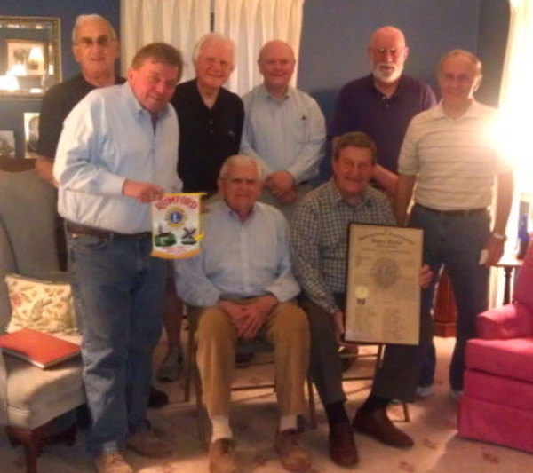A group of Rumford Lions (from left to right) including Peter Barilla, Craig Trodson, Charlie Tsonos, Tony Gomes (seated), Bill Kelly, Dave Lanni (seated), Bob Capello and Richard Cappuccio, recently gathered to discuss the club's 60th anniversary.