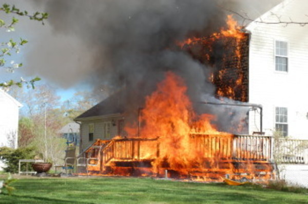 Fire moves fast up the Westport house from a back deck. The roof was gone within minutes. Westport Police photo.